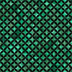 An overlapping pattern of black marble circles with a green marble background.