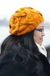 A hat with big drapey cables.