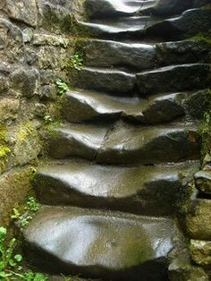 Very old steps, looks like streams of water rolled down these for centuries to get them so snooth and contoured like this. ..rh