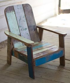 Made of recycled teak and washed in cool, distressed blues and greens