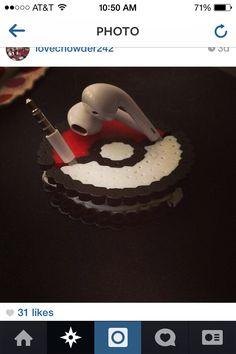 A pokemon ball headphone holders