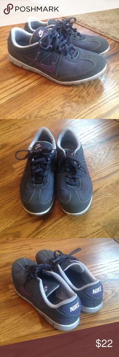 Dark gray and purple Nike sneakers Dark gray Nike running sneakers with a dark purple Nike symbol. Great condition! Nike Shoes Athletic Shoes