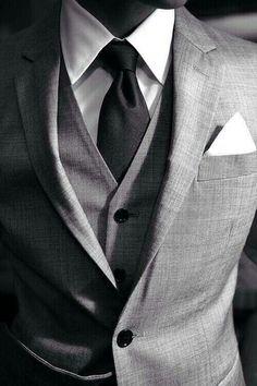 grey suit white shirt black tie