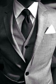 Three piece grey suit white shirt black tie