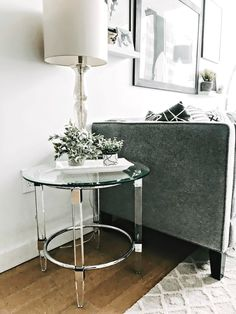 "Get the contemporary edge you crave with the 24"" Greta end table. With beveled and tempered glass as well as metal and acrylic frame materials, this end table will dazzle your guests and leave a lasting impression. Clean, smooth lines will lend an impeccable touch and be the stand-out piece in your space."