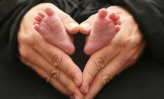 picture idea with your little baby's foot and your hands.