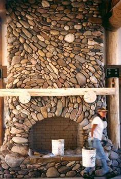Image result for river rock fireplace