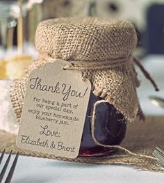 rustic jam jar wedding favour with burlap
