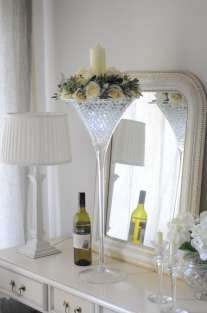 Martini vase with silk roses and candle