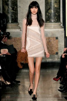 Emilio Pucci Fall/Winter 2013 Ready-to-Wear Collection via Designer Peter Dundas; modeled by Tian Yi