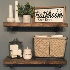 Rustic farmhouse style bathroom sign. Open shelves.
