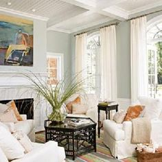 Beachy palette | slipcovers + white drapes + marble fireplace + chair rail & beadboard