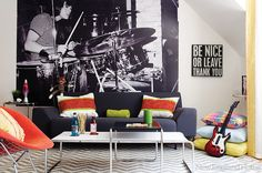 Hip and edgy, yet totally comfortable describes this space for a teen to gather with friends. Patricia Finn's chic design wows, beginning with Landry and Arcari's zigzag cotton dhurrie. The rug pairs with an oversize mural from a 1972 photo to form a backdrop for the lounge-worthy Knoll furniture and pillows in a mix of hot colors and languid neutrals.