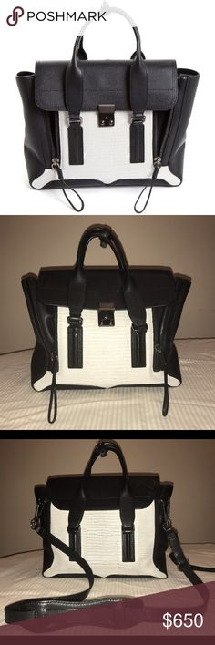 3.1 Phillip Lim Lizard Embossed Medium Pashli Two Tone black and white medium pashli! Great for all seasons. Some signs of wear on the buckle but cannot be seen when closed. More images available upon request. Has a detachable strap to wear as a shoulder/cross body bag. Comes with dust bag 3.1 Phillip Lim Bags Shoulder Bags