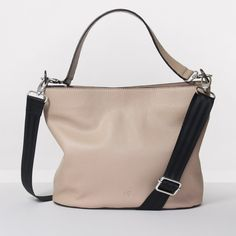 This simple yet stylish bucket bag is made from luxurious leather to ensure a quality finished product. This bag has an internal zip pocket with both the leather top shoulder strap and webbing cross body strap being detectable. This bag comes with a leather key finder with a hook for keys or for the pouch. As you can see a lot of thought has gone into this bag to ensure we give our customers the most impeccable quality of accessories.