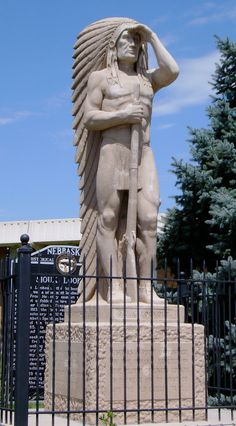 """Sioux Lookout Monument on the grounds of the Lincoln County Courthouse in North Platte, Nebraska.  In 1931, """"Sioux Lookout"""", a sculpture of an Indian chief gazing out from a lookout point was placed atop the highest point in Lincoln county, known as Sioux Lookout, a bluff on the south side of the Platte River a few miles from North Platte. On an unpaved road with a steep climb to the top, but this didn't protect the statue from a great deal of vandalism.  