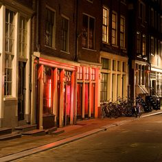 Amsterdam, The red-light district is a main tourist attraction.
