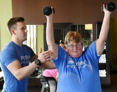 Fittest Loser contestant Sharon Miller works out with her trainer Patrick Stille.