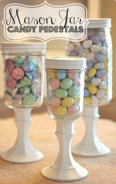 DiY Mason Jar Candy Pedestals--so cute & super easy (and CHEAP) to make using mason jars & dollar store candlesticks! Swap out candy to use for different holidays