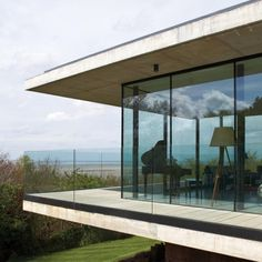 'Rockmount' sits at the top of Caldy Hill, Wirral, with spectacular views across the Dee estuary. The site is set within the Caldy Conservation Area.    The building takes the form of a low, linear plan form, orientated towards the view to the southerly aspect, which reduces the visible mass of the building against the skyline when viewed from a distance.