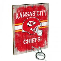 Team Toss for Kansas City Chiefs fans from Team ProMark is a fun and addictive game that's easy to learn but difficult to master. Toss the ring on the eye hook and score a point. The vintage team board designs make a great addition to any fan cave or game room wall. Play individually or pair up for teams while the gang is over watching the game.