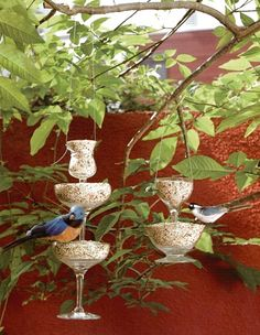 Wine glass bird feeders. Dishfunctional Designs: The Upcycled Garden May 2013