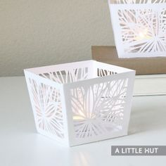 Pattern for making gift boxes.  $1.99. Create a dramatic table setting by cutting a group of these covers or use them to brighten up party favors.     Size:  When cut out of a 12in. x 12in. sheet of paper the largest this cover can be is 4in. x 4in. x 3.75in.