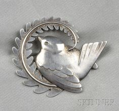 "Sterling Silver Bird Brooch | Georg Jensen.  Designed as a songbird perched on a branch, no. 309, length 2"", signed Georg Jensen, Denmark. Light wear to crispness of detail, otherwise without issues."
