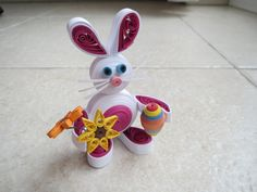 Cute quilled easter bunny or rabbit with the easter egg and a bouquet of flowers, All made of paper, except the flowers' stem. on Etsy, $28.15