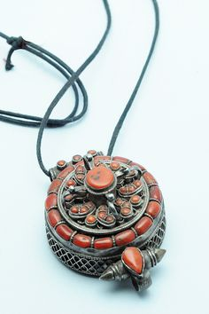 Old silver tibetan gau amulet box pendant with a central coral tibetan prayer box necklace aloadofball Image collections