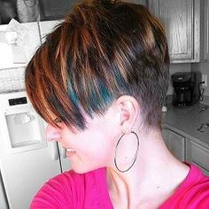 Asymmetric style pixie with tight taper.  nice blending awesome cut and color