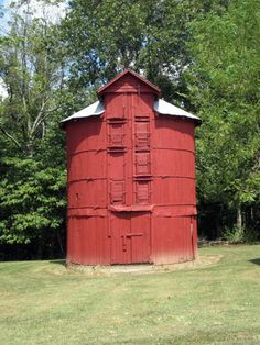 Round Red Silo. What an awful job that must have been to fill with different doors for each level. I am curious as to what was stored in it.