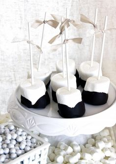 marshmallows with chocolate on sticks with bows ❥