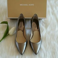 Beautiful Michael Kors Pump New Never Worn Beautiful Brand New Michael Kors  Pump  Color Gunmetal  Size 8 Smoke free home.  feel free to make an offer price are negotiable.  Happy shopping and have a blessed day. MICHAEL Michael Kors Shoes Heels