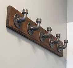 Crafted of pine wood and black steel pipes. The black steel pipes come in a natural grey color as shown in the picture or can be painted with an oil-rubbed bronze finish while the pine wood shelf is… Industrial House, Industrial Style, Industrial Coat Rack, Industrial Pipe Shelves, Rustic Industrial Decor, Industrial Bathroom, Diy Furniture Industrial, Boys Industrial Bedroom, Plumbing Pipe Furniture