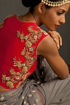 Red georgette sleeve less blouse with beautiful zardosi work