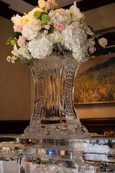 A stunning custom ice sculpture topped by fresh blooms for Tiffany + Dustin's fairy tale inspired wedding at the Dallas Country Club | DFW Events | Photo: Luke Edmonson, Edmonson Weddings