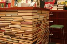 This is so cool! Even better if covered with a glass tabletop, so that the books are visible.