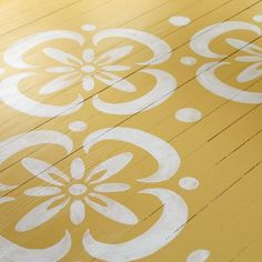 Add one coat of paint for a weathered look as you DIY a stencil pattern on your floor.