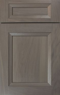 Whitney II Recessed door style by #WoodMode, shown in Matte Shale finish on walnut.