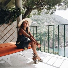 Enjoying our beautiful balcony view in my favorite striped espadrilles! ❤️ - @sincerelyjules