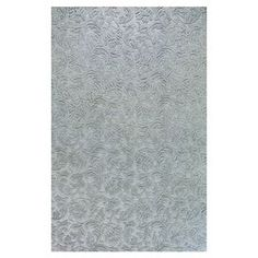 Hand-tufted wool rug with vine motif.  Product: RugConstruction Material: 100% WoolColor: Light blueNote: Please be aware that actual colors may vary from those shown on your screen. Accent rugs may also not show the entire pattern that the corresponding area rugs have.Cleaning and Care: Vacuum regularly. Spot clean.