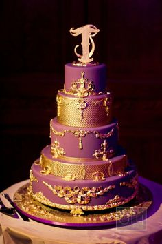 Google Image Result for http://thebridalcircle.com/wp-content/uploads/2012/06/purple-and-gold-stacked-round-tier-wedding-cake-new-york-city.jpg