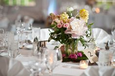 Joseph Kang Photography. Vale of Enna flowers. Peony. Spray Rose. Stock. Garden Rose. Ranunculus. Jasmine Vine. Dusty Miller. Pink, Yellow, White, Green, and Grey. Centerpiece. Chicago Wedding.