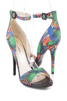 Walk around town in these cute single soles, it features printed canvas, open toe, wrap around ankle strap, stitched detailing, cushion footbed and finished off with an easy slip on. Approximately 4.75 inch heel