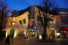 The Krzywy Domek Crooked House, Poland at Nighttime