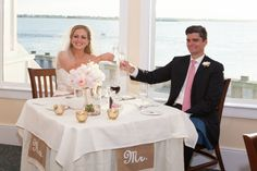 The bride & groom toast at their sweetheart table.