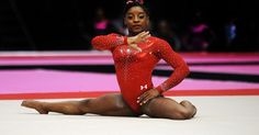 Simone Biles beat reigning Olympic champion and United States teammate Gabby Douglas to win her third consecutive all-around title at the world championships, making her the first ever female gymnast to do so.