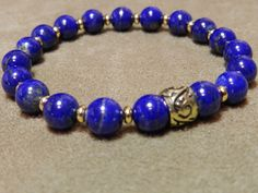 Intense Blue Lapis Lazuli with Gold Plated Heishi Spacers and an Antique Gold Bali Bead Stretch Bracelet by JewelsYogaTurtle on Etsy https://www.etsy.com/listing/184381712/intense-blue-lapis-lazuli-with-gold