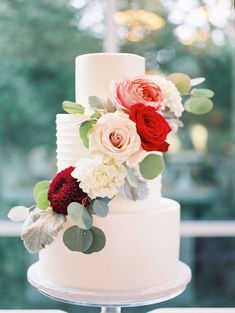 White Wedding Cake Adorned With Red Flowers | Tracy Enoch Photography via Elizabeth Anne Designs